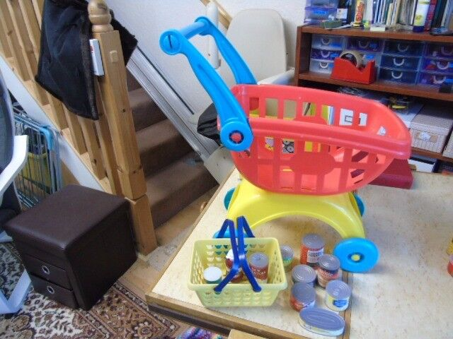 child's shopping trolley and shopping