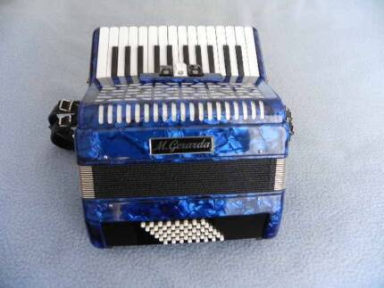 PIANO ACCORDION M. GERARDA 48 BASS WITH TROLLY TYPE CASE