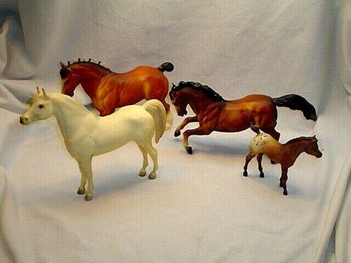 FOUR BREYER HORSES**