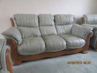 DFS Charlotte, lagoon green leather three piece suite sofa with teak trim