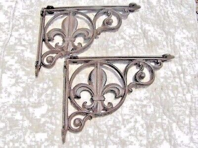 Two Cast Iron fleur de lis Shelf Brackets