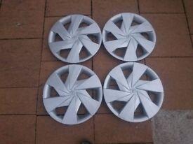 "Genuine Toyota 15"" wheel trims."