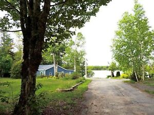 Great Summer or Year Round Home with 150' of Lakefrontage