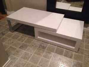 Beautiful white coffe table rotates 360 degrees...$300