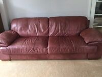 Large 4 seater leather sofa, large armchair and storage footstool for sale.