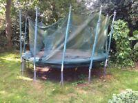 Trampoline, 12' (10' mat). a bit tatty (has been under tree) and safety net needs bit of maintenance