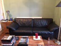 Beautiful retro ultra-comfortable Danish 1970s black leather sofa.