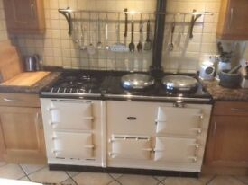 Superb cream AGA cooker, oil fired, with companion. Two AGA oven and two electric. Gas hob. Perfect.
