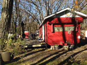 Affordable Trailer Cabin for sale in Oak Lake Beach.