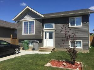 2011 Built home, 4 br 2 bath. Large deck and back yard. July 1st