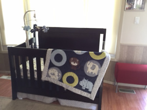 Baby crib, bedding, mattress, and mobile included