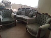 Settee and 2 chairs on carved wooden frame