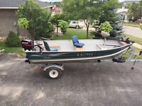 2005 14' Lund aluminum deep and wide boat with a 25hp Merc