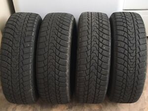 4 Winter Tires & Rims. 185/65R/14. 4 Bolt Pattern. JUST LIKE NEW