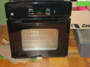 GE wall mounted stove   Black  in color    In great condition