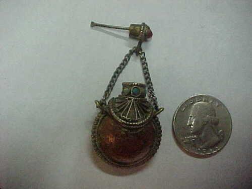 Pendant. Bottle for perfume, metal. Handwork