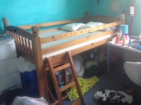 Cabin Bed with underneath den/storage. Wood with ladder and wood supports all round.