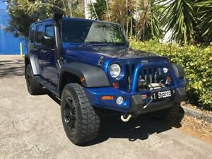 2009 Jeep Wrangler Unlimited JK MY09 Sport (4x4) Blue 6 Speed Manual Softtop Bowen Hills Brisbane North East Preview