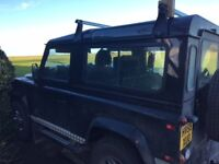 Low Mileage, Excellent Condition Landrover 90 County 2009 Black with checker plate trim.