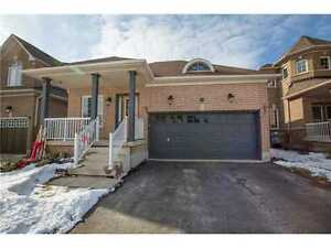 BEAUTIFUL BUNGALOW W/ FIN BSMT CLOSE TO GO TRAIN