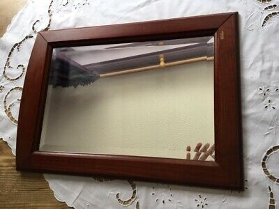 Hardwood framed superb mirror.  35cm x 50cm.  Elegant luxury.  Collect only