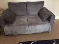 grey two seater sofa bed