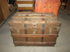 Antique camel back steamer trunk - 6385