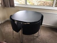 Black Hygena dining table and chairs