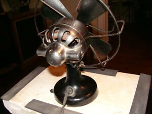 Three vintage/antique fans, two Electrohome Kitchener plus one,