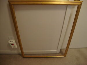 Gold coloured frame in brand new condition