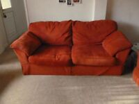 Terracotta coloured settee. two 3-seaters and one 2-seater. Will sell separately