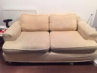 Generous two-seater cream sofa