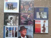 A collection of CDs by Frank Sinatra, Dean Martin, Sammy Davis Jnr.