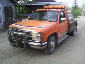 1992 Chevrolet tow truck. ,     Weekend SALE     Open to trades