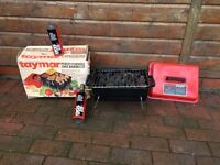 Portable gas bbq unused with two re-fills and rocks