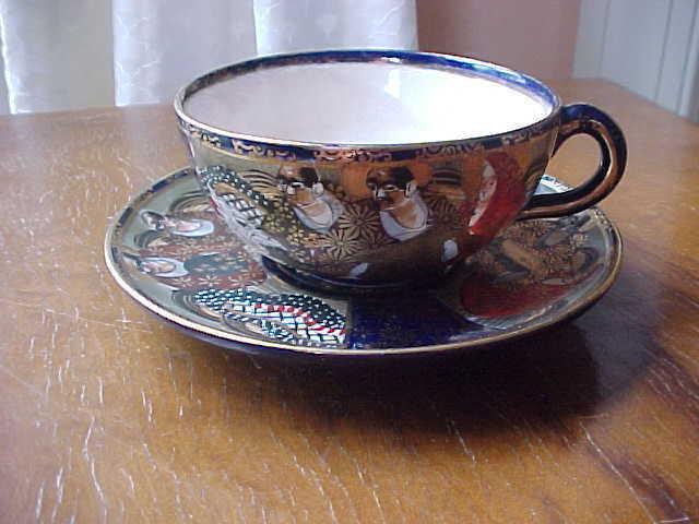 Japanese Meiji Satsuma signed scholars and dragon teacup and saucer