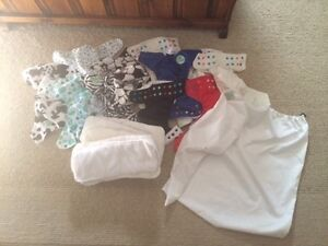 Cloth Diapers barely used, one large&one small laundry/wet bag.