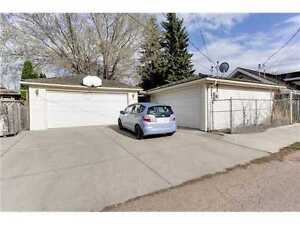 BASEMENT SUITE WITH FULL SIZE GARAGE! RAVINE LOCATION!