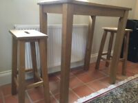 Oak breakfast bar/table with two stools