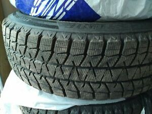 4 almost new Bridgestone Blizzak 215/65/17 winter tires