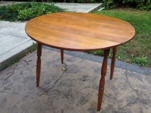 Hardwood circular folding table
