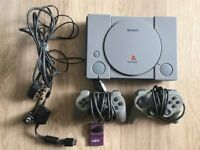 Playstation 1 + 2 controllers + 9 games