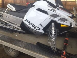 His and Hers Polaris Pro-RMK's with trailer