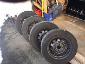 4 -  Michelin ICE X tires and Steel Rims (185/65/R14)