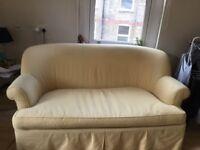 A Yellow and white elegant 2 seat sofa