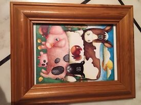 Framed photo of an animal scene for a nursery wall