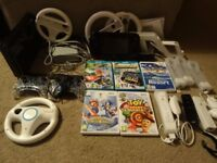 Nintendo Wii U 32GB console bundle with game pad, games and various controllers