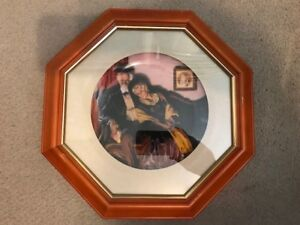 11 Norman Rockwell Plates framed..... All numbered in frames.