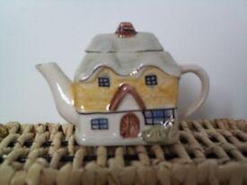 Unmarked minature china 'cottage' teapot