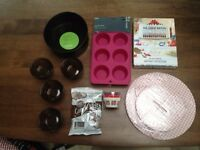 A range of baking items: Cake tin, muffin tin & cases, cupcake stand, glass ramekins & GBB Book